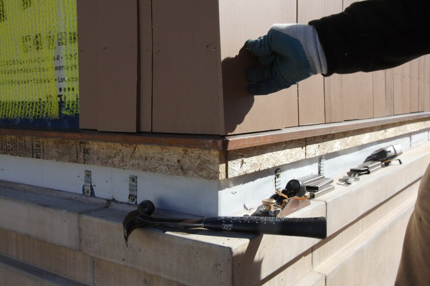 For the outer layer on the bottom course, hold the shingle in place making sure that the clearance at the bottom of the shingle is even with the shingles on the starter course.