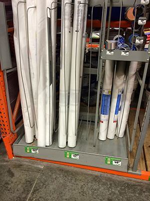 Identical looking rolls of white housewrap, but vastly different prices