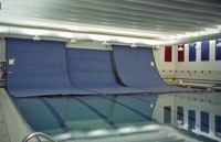 Wall-Mounted, Push-Button-Operated Automatic Swimming Pool Covers from Alta Enterprises