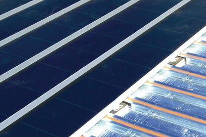 The Solar Sandwich roofing system contains a solar thermal system in an otherwise ordinary roofing system.