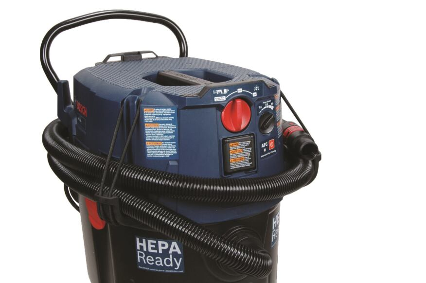 Hose management. Bungee-like hose-wrap hooks on the Bosch unit help to manage an otherwise disorderly vacuum hose.