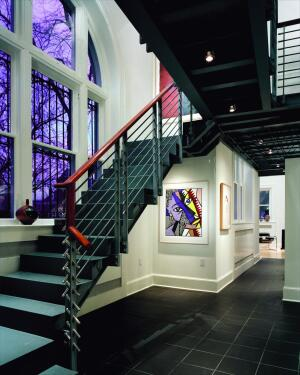 The client, originally from Philadelphia, asked a Philadelphia firm, Brawer & Hauptman Architects, to design the bank renovation. Glass Construction cleaned and renovated the exterior of the 1906 building and gutted the interior, adding a custom steel staircase leading to a steel mezzanine.