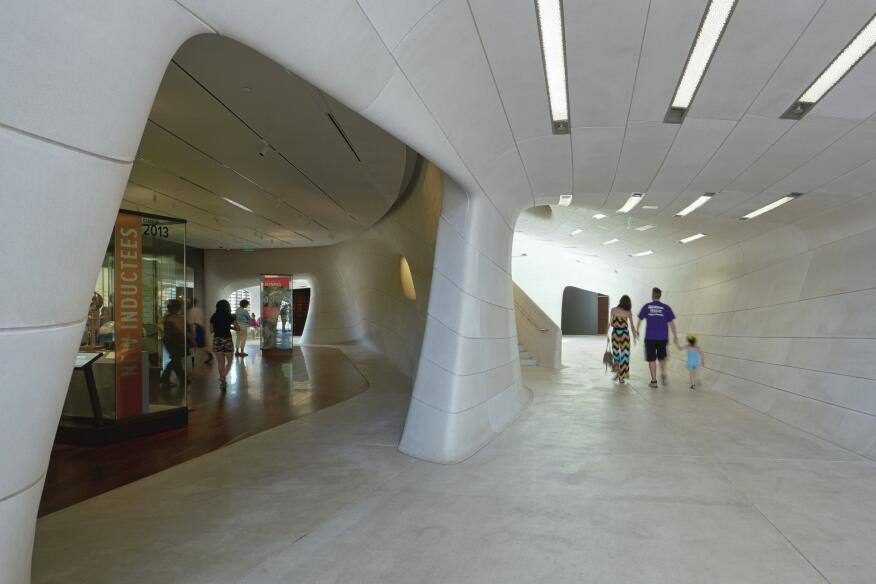 Inside, in the public spaces, cast-stone walls give way to Italian floor tile from Flor Gres. In the first-floor galleries, which hold exhibits related to the Sports Hall of Fame, the tile transitions to warm wood from Allegheny Millwork.