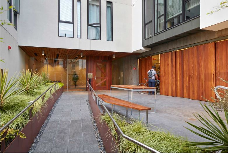 Barn doors conceal centrally located bicycle-storage rooms at David Baker Architects' 300 Ivy project in San Francisco.
