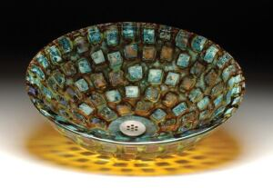 Glass artisan Steve Weinstock, of Alchemy Glass & Light, found inspiration for his Celestial Series of sinks in the iconic work of artist Jasper Johns. The colorful Mosaic model, shown here, is created by fusing reclaimed shards of glass into a 3/4-inch-t