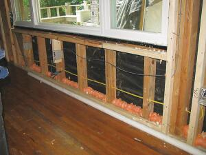 When contractor James Pader removed the wallboard on this 1959 cabin, he could see the gaps that caused air leakage in the original structure. He sealed gaps and cracks with expandable foam and furred out the existing 2x4 framing to 2x6 to create a 5†1/2-inch cavity for fiberglass insulation to create an R-value of 19.