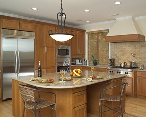 A 4 -foot-wide aisle between the kitchen island and surrounding cabinets  allows