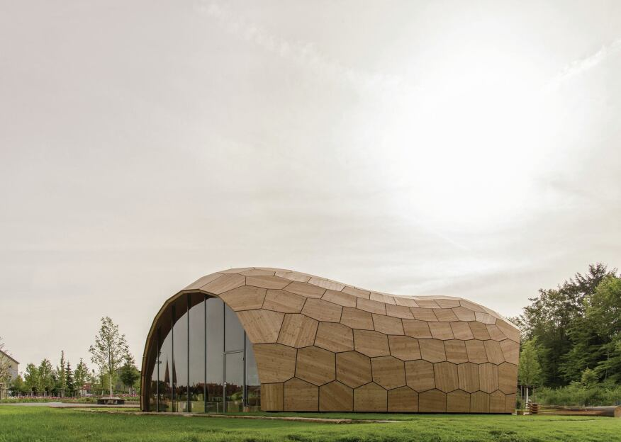 The exterior of the pavilion is clad in untreated larch plywood panels.