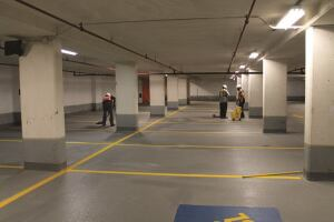 Contractors install protective coating on a parking deck floor slab in accordance with ACI 562, which was developed specifically for concrete repair. A new guide to the code helps clarify designers' and contractors' requirements and responsibilities.