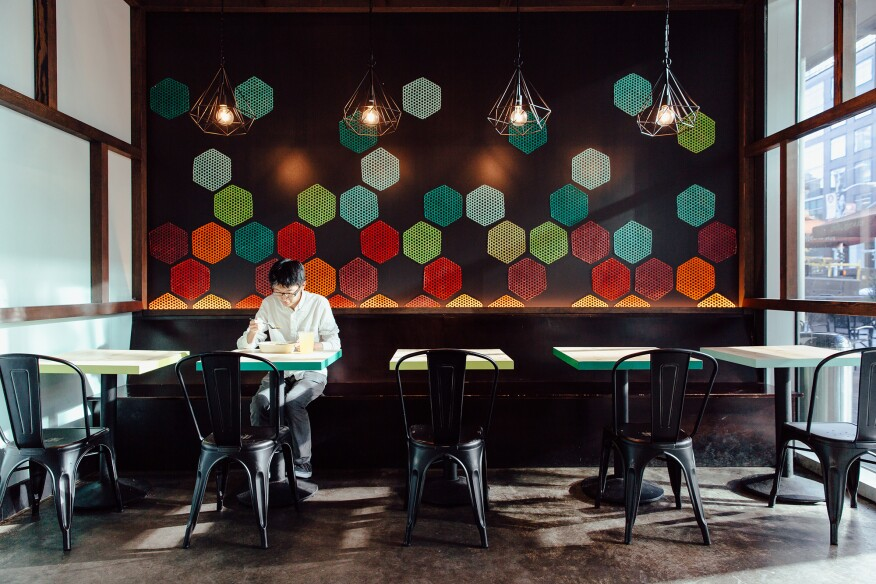 Painted bamboo mats create visual interest on the wall of Spice Kit restaurant in San Francisco.