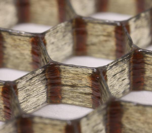 Researchers at Harvard University have developed a carbon-fiber reinforced epoxy ink, shown here printed in a hexagonal honeycomb.