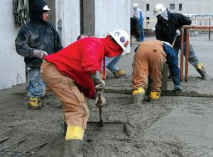 """With the """"wet screed"""" approach, the finishers use the surface of freshly placed concrete to guide strike-off in adjacent areas."""
