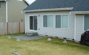 Figure 1. A featureless backyard with no real entertaining space can be easily improved by the addition of a deck.