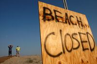 New York Issues Tickets to Beach Walkers, Taxes Rebuilders