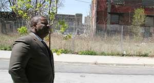 Carl Greene, executive director of the Philadelphia Housing Authority, surveys a parcel of land that sparked a dispute between PHA and HUD.