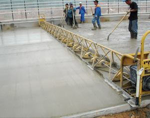 Vibrating truss screeds finish flat slabs, such as streets, ramps, and driveways.