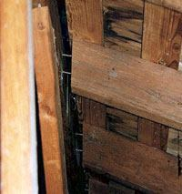 A sinking foundation often manifests in separation at the ridge beam.