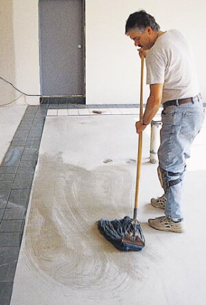 Dirty substrates create poor bonding conditions. Concrete substrates should be wet mopped and plywood substrates damp mopped, with the mop water changed regularly.