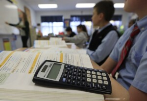"In this Tuesday, Nov. 17, 2015 photo, a students work in a seventh grade accelerated math class at Holy Spirit School in East Greenbush, N.Y.  The Diocese of Albany, New York, announced recently that it will reduce the frequency of the Common Core-aligned tests while sticking with the standards. The decision coincides with a call by New York Gov. Andrew Cuomo for ""a total reboot"" of the Common Core after his state became the epicenter of anti-testing sentiment. (AP Photo/Mike Groll)"