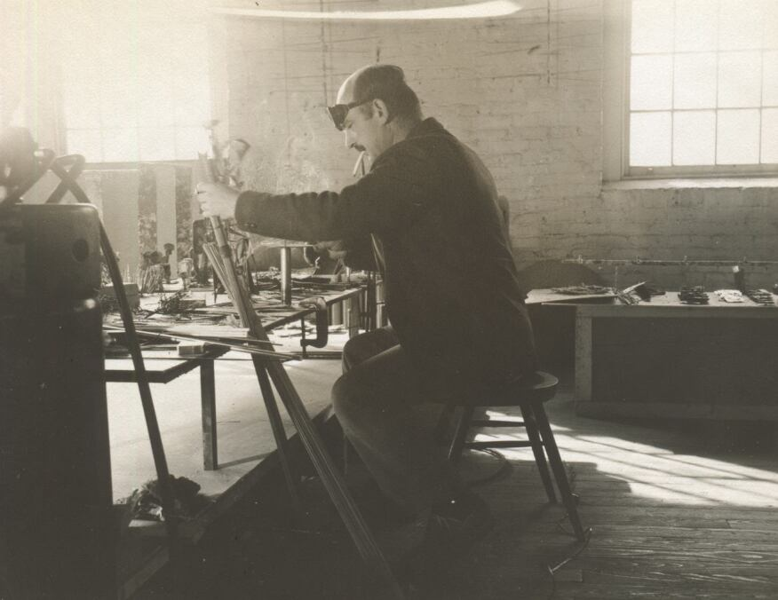 Bertoia working on his sculptures in his renovated Pennsylvania Deutsch fieldstone barn that he used as a studio for recordings.