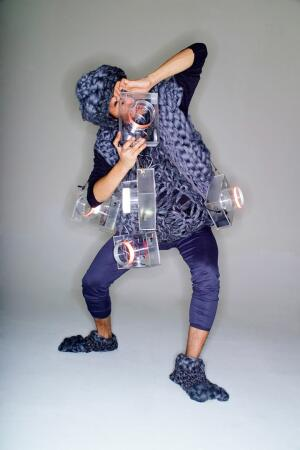 In Object of Desire, Taeyoon Choi and E Roon Kang demonstrated a wearable computer in a performance, 2006.