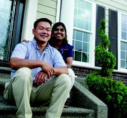 SPEAK THE LANGUAGE: Trong Hong and his wife, Rani, came to America as adopted children from, respectively, Vietnam and India. Asian buyers seek out their eight-year-old company, Olympia, Wash.–based Tronie Corp., says Rani, because she and her husband are bilingual. Tronie specializes in move-up custom homes (such as the one at right) that, she says, are distinguished by their details.