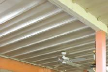 DrySpace's V-shaped vinyl panels hang from ledgers that are fastened and taped to the sides of the joists.