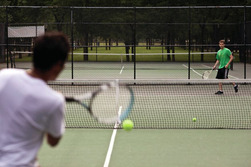 A pair of tennis courts take up one block of the tree-lined mall at Harbor Point.