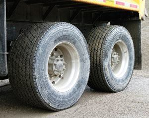 Michelin's X-One double-wides replace traditional low-profile duals — one 445/50 R 223.5 replaces two 275/80 R 22.5s — which increases traction and consumes less energy. Photo: Michelin North America Inc.