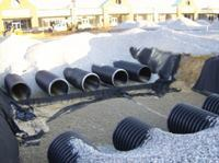 Due to impervious subgrade, cisterns and drain pipes were placed underneath to help collect the stormwater.