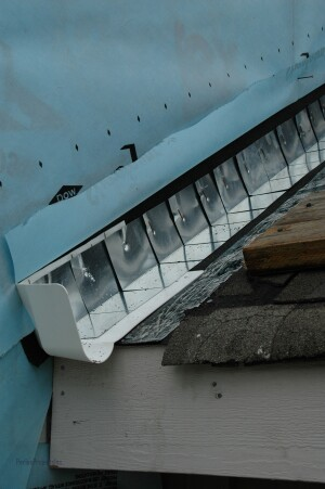 A pre-made, one-piece TPO kickout, like this one from DryFlekt, is large enough to deflect roof runoff into the (yet-to-be-installed) gutter.