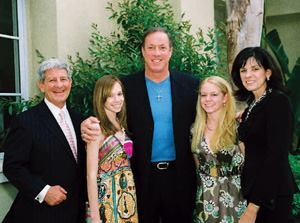 Hall-of-fame quarterback Jim Kelly (center) joins the Stack family (L-R): Jeff, Alexandra, Natalie, and Nancy.