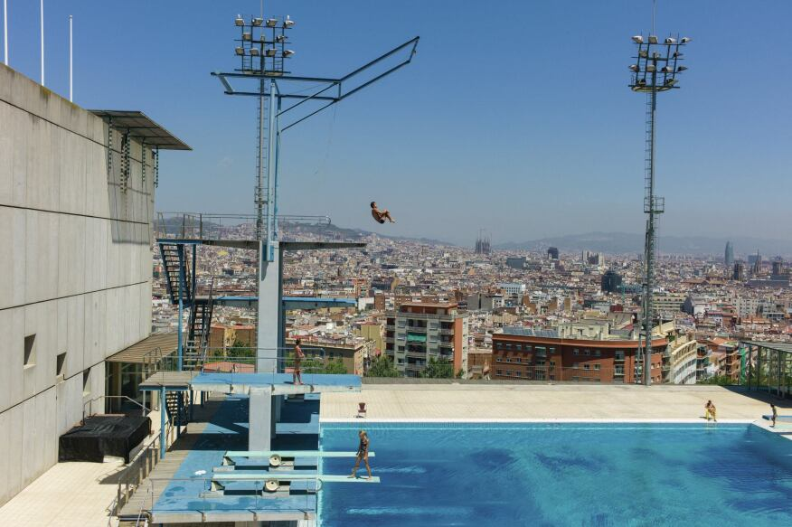 Barcelona 1992  The best view of Barcelona may be from the high dive of the Montjuïc Municipal Pool, the hilltop site of the diving events and the water polo preliminaries in 1992. The facility opened for the 1929 Barcelona International Exposition, and was tabbed as a venue for the anti-fascist Olympics, a proposed alternative to the 1936 Berlin Games that was canceled due to the Spanish Civil War. For the '92 Games, a large part of Montjuïc was renovated under the supervision of architects Federico Correa and Alfonso Milá. The pool hosted the diving competition for the 2013 World Aquatics Championships.