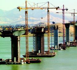 Unsupported decks reached as far as 300 feet from piers before they were joined together to complete spans.
