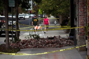 Bricks from an unreinforced masonry building still block the sidewalk on Main Street in Napa, Calif., Monday morning, Aug. 25, 2014, one day after the South Napa earthquake struck the Bay Area.  (Karl Mondon/Bay Area News Group)