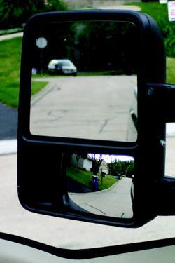 Aim mirrors so the horizon is closer to the top edge for better coverage of  blind spots close to the sides of the truck.