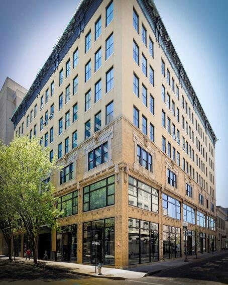 The development team retained the building's original type of exterior cladding to qualify for federal and state historic tax credits.
