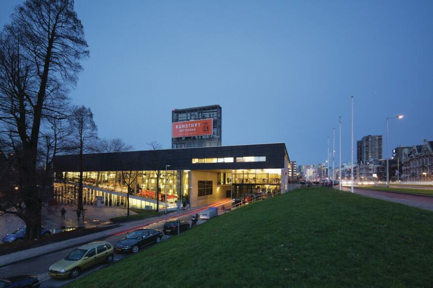 As viewed from the southeast, the Kunsthal is intersected by a service road and edged by a highway to the south.