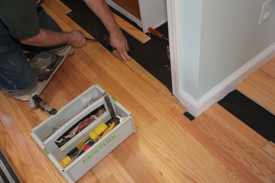 Proper moisture content in wood flooring and in the subfloor, along with adequate nailing, lets the flooring be installed without an expansion space.