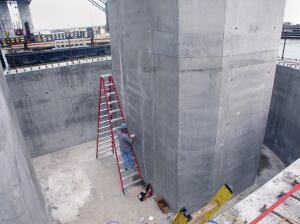In some instances, replacement may prove to be the better option for an older structure with a few years left before the life cycle of the structure ends. In all cases, it is prudent to bring in an engineer for a structural and life cycle evaluation. If the damage is not disruptive to the entire structure, it often is best to repair. Here, crack injection is applied to a large bridge column in Galveston, Texas.