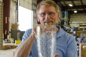Marshall Richardson, president and founder of Tara Manufacturing, with PoolCorp's Vendor of the Year Award