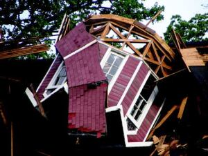 The collapsed structure is beyond repair, but preservationists hope to salvage the cupola and other barn elements.