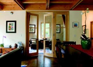 FRAME AND SAVE: Exposed 1x2 Douglas fir framing lends a casual, organic warmth to the home's  fluid interior spaces. The kitchen cabinets (below) are made of manufactured  maple.