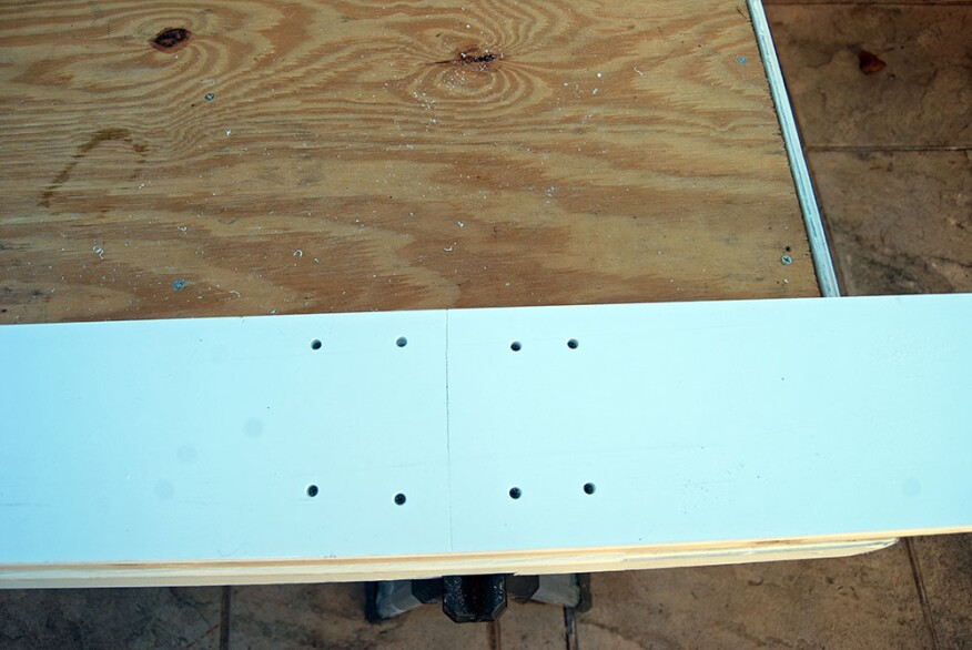Four more fasteners are used to secure the second length to the substrate while the PVC adhesive in the lap joint cures.
