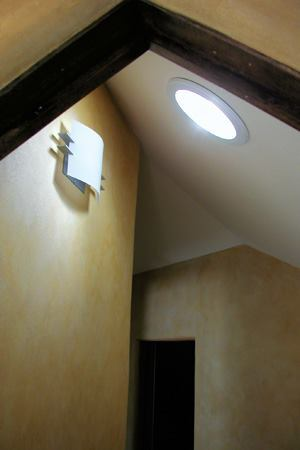 Participants in Solar Energy International's programs on sustainable home design learn about the benefits of implementing daylighting strategies. One way to help cut down on the use of electric lighting during the day is to install tubular skylights, such as the one shown above that is in a hallway of a private residence.