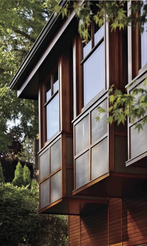 Three window bays extend the master bathroom and dressing space. Copper panels in a shoji-like pattern are a subtle Asian reference.