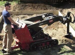 Three-foot-deep holes take about 5 minutes each with a machine-mounted auger.