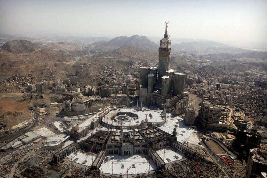 The tallest clock tower in the world with the world's largest clock face at the Abraj Al-Bait Towers overlooks the Grand Mosque and its expansion in Mecca, Saudi Arabia.