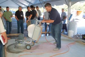 Outdoor grinding and polishing demonstrations are popular at the International Concrete Polishing & Staining Conference.