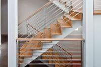Sleek Stairs Zigzag Through Center of Modern Remodel